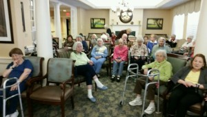 Residents at senior facility gather to hear discussion on fall prevention.